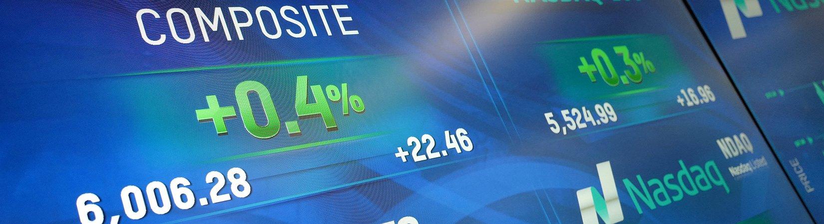 NASDAQ crosses 6000-point milestone