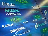 NASDAQ crosses 6000-point milestone