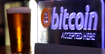 Bitcoin climbs to within touching distance of record high