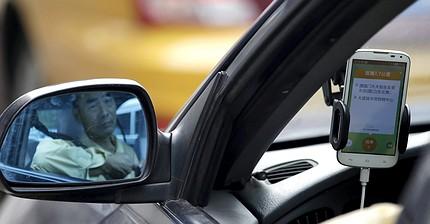 Uber fusionará su negocio en China con su rival local Didi Chuxing