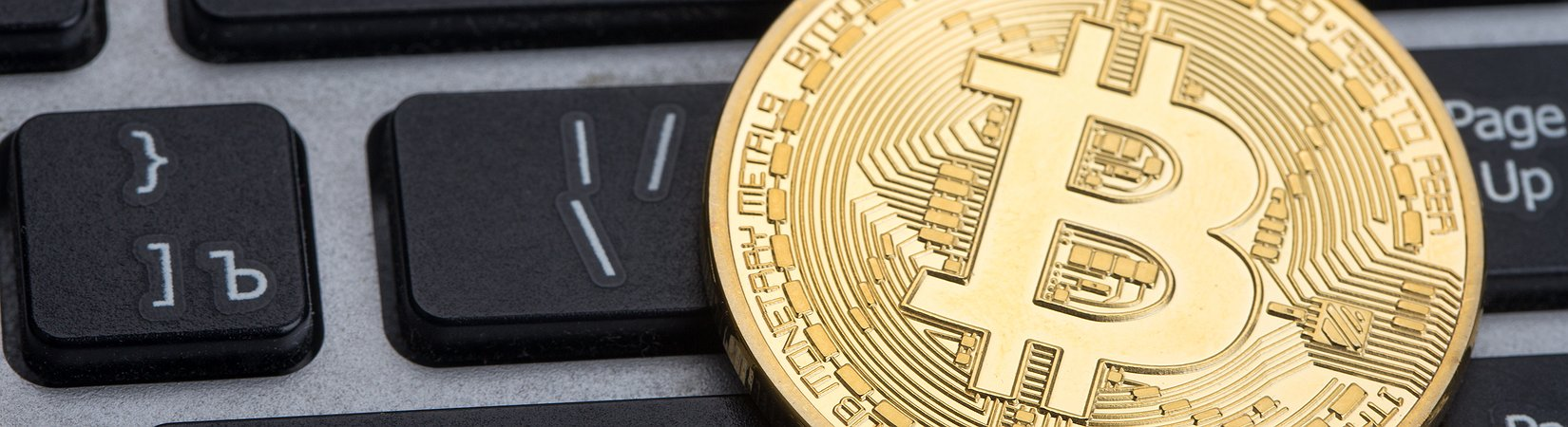 Bitcoin plunges more than 20 percent on fears currency could split