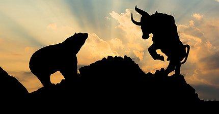 Быки vs. Медведи: Кому на руку запуск фьючерсов на биткоин?